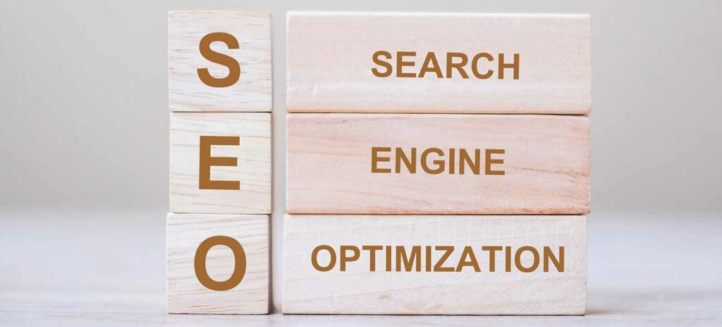 6 wooden blocks on a white background that spell SEO and search engine optimization as header on learn seo for free guide